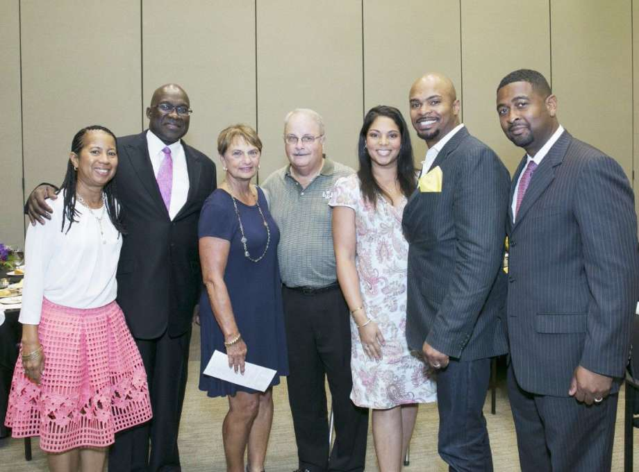 The MCWC awarded 21 scholarships last month to domestic violence survivors. Pictured are, from left to right, Cheryl and Jesse Tyson, featured guest speaker; JoAnne Lowry, MCWC board member, and Randy Lowry; MCWC scholarship donors Maya and Datren Williams, MCWC board member; and Dana Carter.