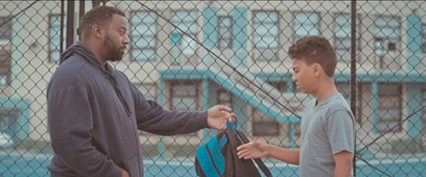 "A still from Jehnovah Carlisle's Day by Day, featuring Carvell Wallace (""Michael"") and Ezra Wallace (""Johnny"") from left to right."