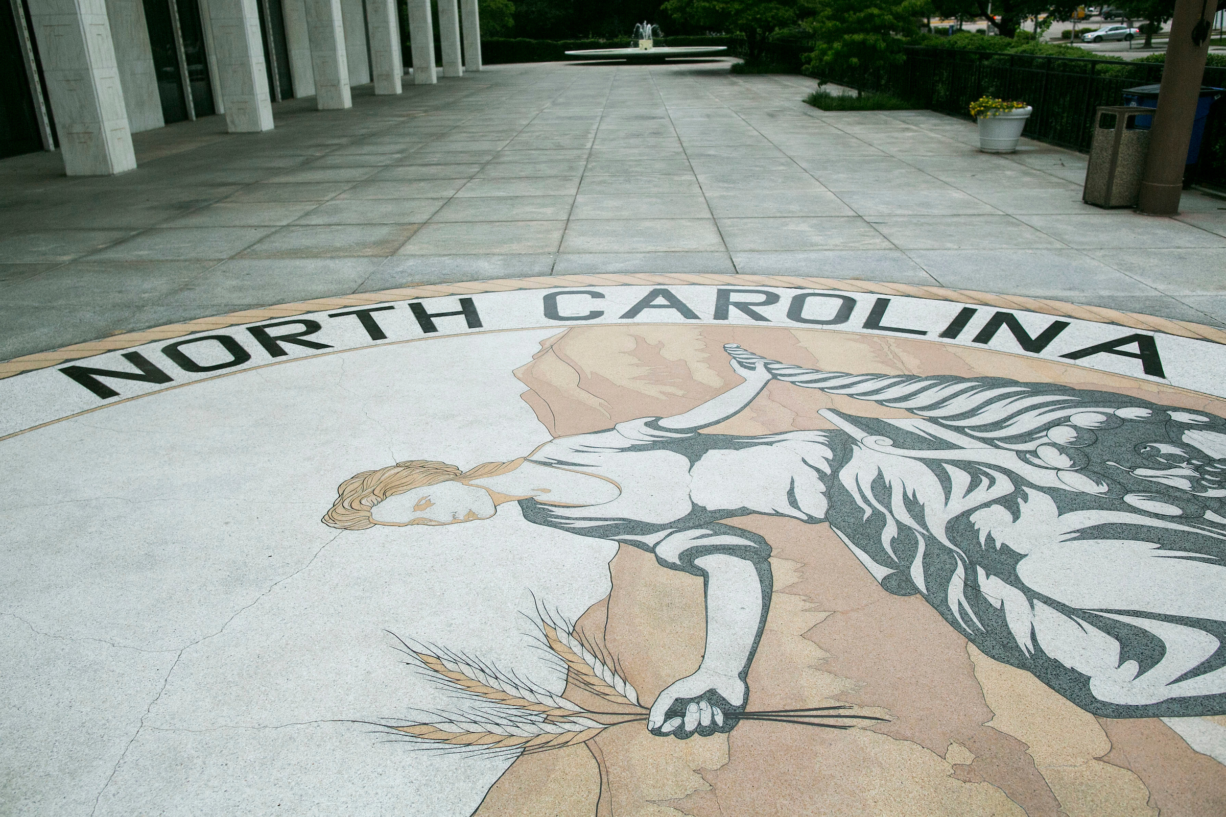 UNITED STATES - MAY 9 - The great seal of North Carolina is seen outside the state legislature building in Raleigh, N.C., on Monday, May 9, 2016. Gov. Pat McCrory and his administration sued the federal government Monday in a fight for a state law that requires transgender people to use the public restroom matching the sex on their birth certificate. (Photo By Al Drago/CQ Roll Call)