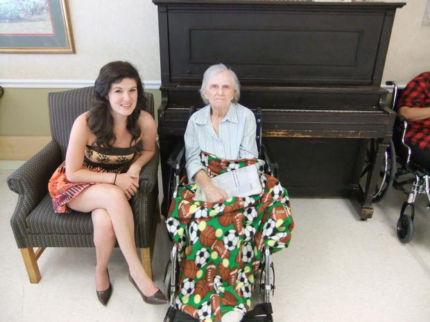 A young woman and an elderly female patient at a nursing home both receive health benefits from thei...