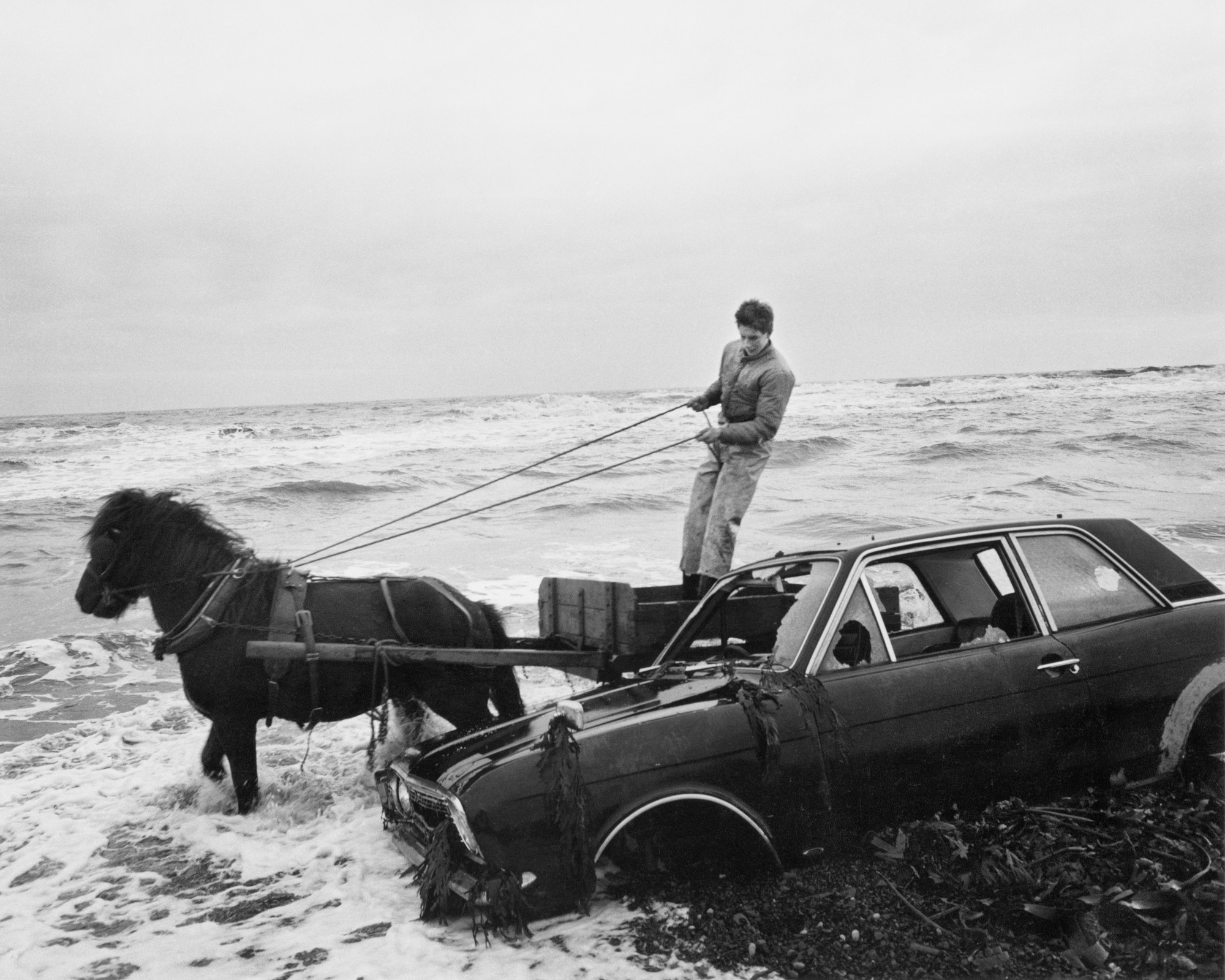 """""""A car dumped on the beach..."""" by Chris Killip, from 1982, at the Getty Museum."""