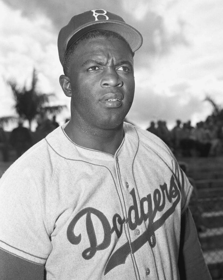 """Jackie Robinson wrote in his autobiography, """"I cannot stand and sing the anthem. I cannot stand salute the flag."""""""