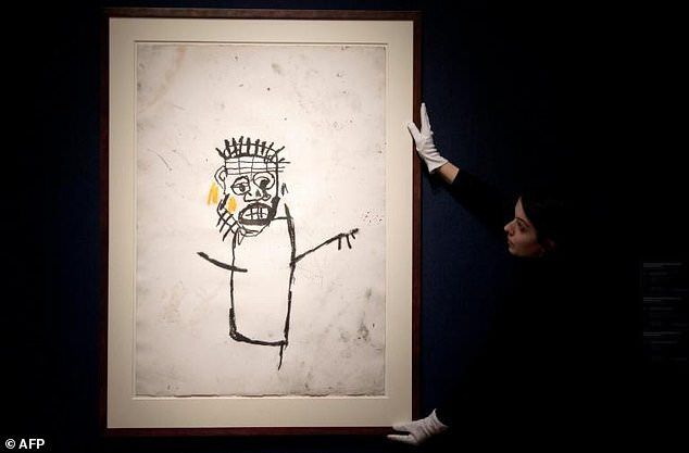 An artwork by Jean-Michel Basquiat, 'Untitled', seen on display during a photocall for the Post-War and Contemporary art sale at Christie's in London, in March 2017