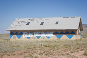 "Graffiti on a building on the Navajo reservation reads, ""Fuck the police."""