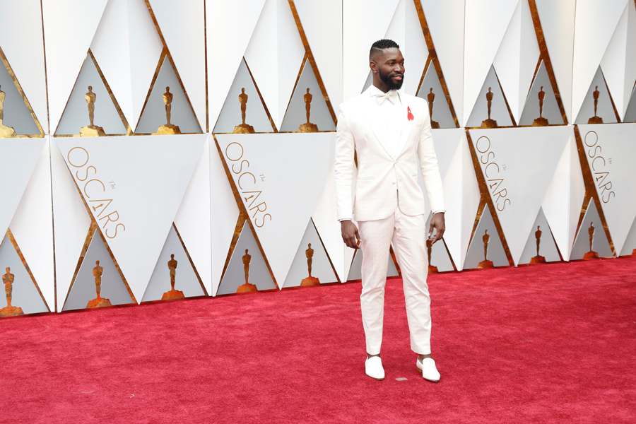 Playwright Tarell Alvin McCraney poses at the 89th Academy Awards in February. McCraney spoke about how his experiences as a black, queer artist have influenced his scripts at a Friday event.