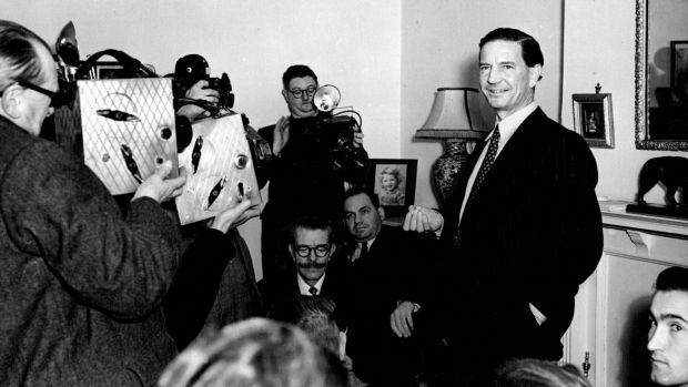 Kim Philby is surrounded by media at his mother's home in West Kensington after his name surfaced in the MacLean-Burgess ...