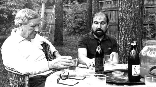 Kim Philby (left) and George Blake talk over a bottle of wine, July 1979.