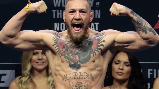 Tats enough: Conor McGregor shows off his body art.