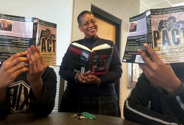 Karen Lemmons, library media specialist at Detroit School of Arts, reads The Pact with high school students. Photo courtesy of Karen Lemmons.