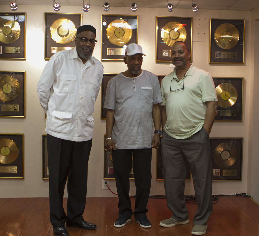 Kenneth Gamble, Leon Huff and Thom Bell, from left, pose in front of a wall of gold records at Gamble and Huff Music in Philadelphia, during a rare trip back home for Bell. The three are partners in a music publishing company. Gamble and Huff were inducted into the Rock & Roll Hall of Fame in 2008. (Stephanie Aaronson / The Philadelphia Inquirer, 2013)