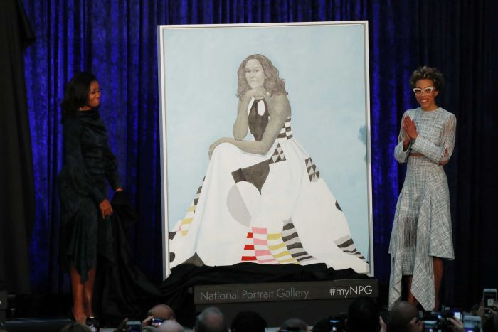 Former first lady Michelle Obama beside her official portrait