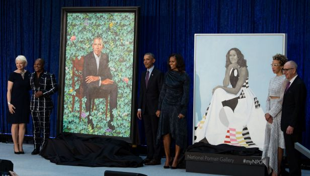 National Portrait Gallery director Kim Sajet (far left) unveiled the official portraits of Barack and Michelle Obama ...