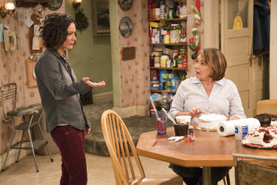 "This image released by ABC shows Sara Gilbert, left, and Roseanne Barr in a scene from ""Roseanne."" Gilbert says she still supports ABCâ s"