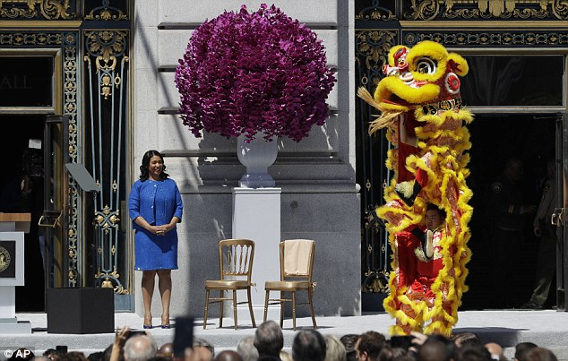Breed watches dragon dancers perform before she is sworn in as San Francisco's new mayor Wednesday