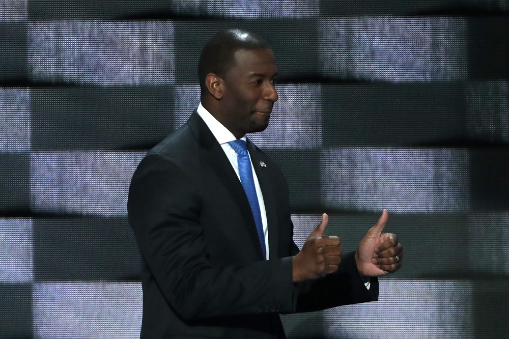 Tallahassee Mayor Andrew Gillum gives two thumbs up as he walks on stage to deliver remarks on the third day of the Democratic National Convention at the Wells Fargo Center, in Philadelphia. — AFP pic