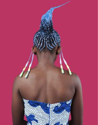 Portrait by Medina Dugger showing African hair braiding