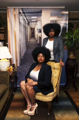 Portrait by Endia Beal showing two women dressed for the corporate workplace