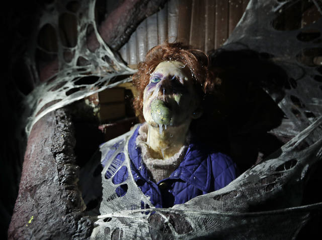 "In this Wednesday, Sept. 12, 2018 photo, the character Barb appears in grand, gory style in the Stranger Things haunted house during Halloween Horror nights at Universal Studios in Orlando, Fla. The ""Stranger Things"" house is one of 10 haunted houses built for this year's Halloween Horror Nights running through early November. (AP Photo/John Raoux)"