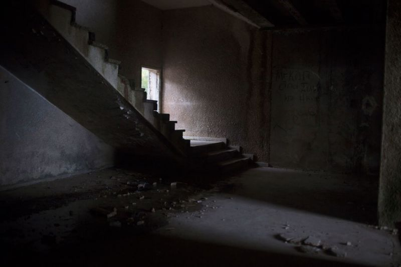 A room in the abandoned Ducor Hotel in Monrovia, Liberia. Several girls in the trial named the Ducor as a place where they were raped by Macintosh Johnson. At one time, it was a four star hotel, one of the finest in all of Africa, but if fell into disrepair during Liberia's civil war. After the war that ended in 2003 it was inhabited by squatters. They were cleared out in 2010 when Libyans won a bid to rehabilitate the hotel. When crisis broke out in Libya, the hotel was again abandoned.