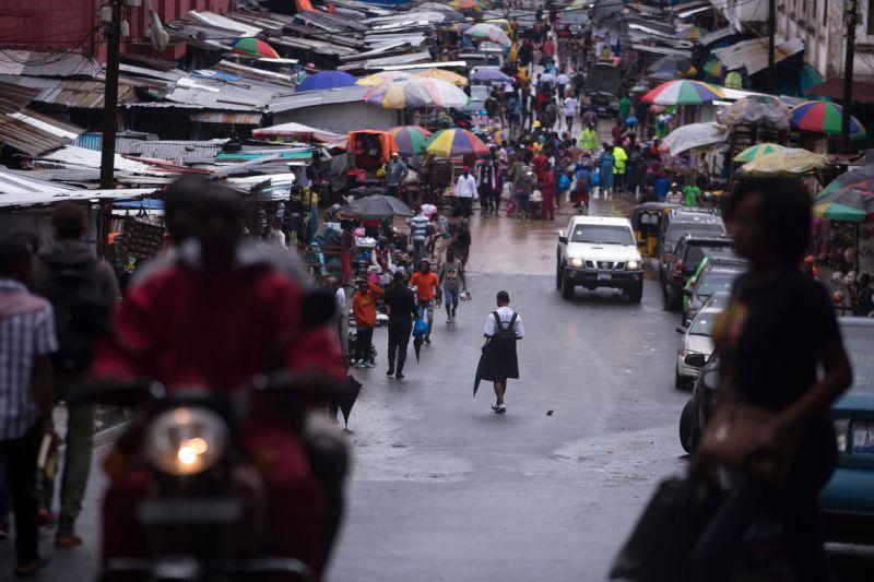 A school girl walks towards Waterside Market in Monrovia, Liberia.