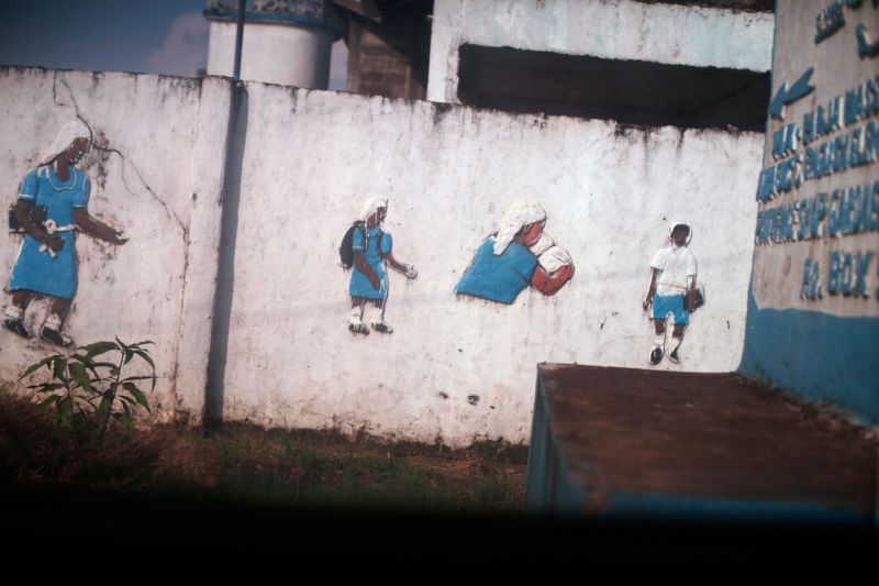 Paintings on a school wall in Monrovia, Liberia.