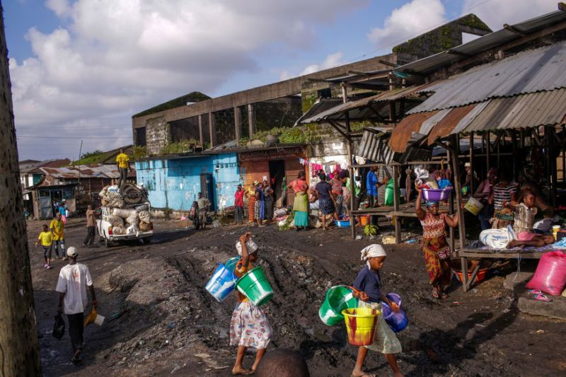 Children walk through Duala Market in Monrovia, Liberia.