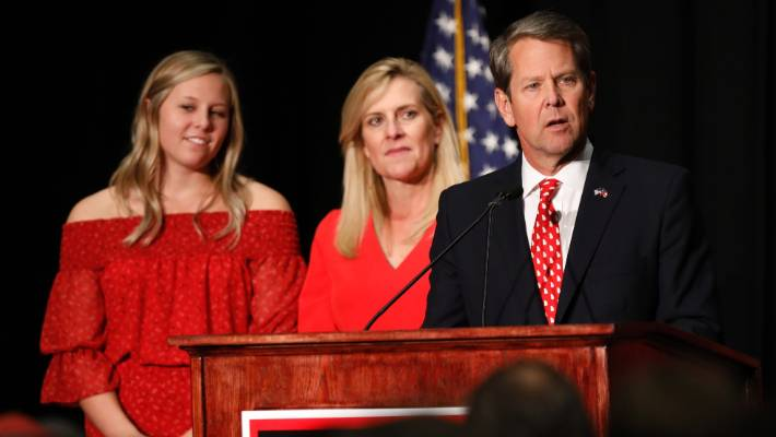 """Brian Kemp, days before the midterms, launching an investigation into Democrats, alleging a """"hacking"""" attempt into the voter registration system."""