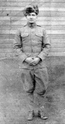 Cpl William Roper, who fought in the Meuse-Argonne Offensive of 1918 while assigned to Company F, 366th Infantry Regiment, 92nd Infantry Division, poses in his World War I uniform.