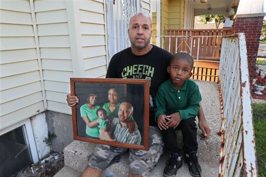 Alvin Blalock, and his son, Alex, 5, at their Milwaukee home. Alex's mother, Tiffany Tate, suffered a stroke 350 yards from a Froedtert Hospital, a top-tier stroke center, but was taken to a different hospital that offered only limited stroke care. She later died.