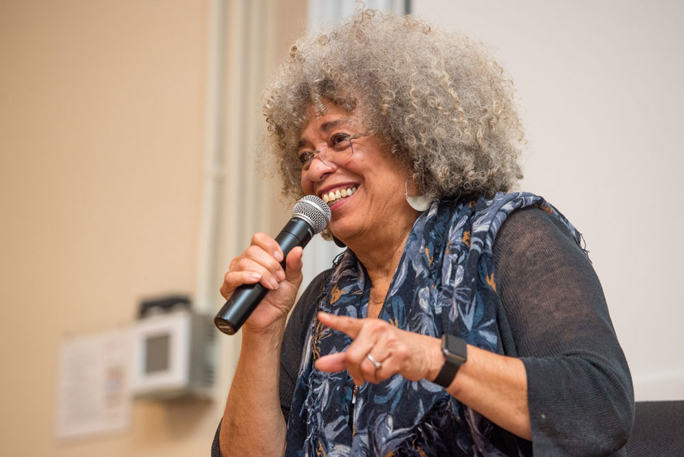 "Angela Davis, who has won many accolades and honors, and stirred controversy, over the course of her nearly half century of activism, urged her audience to imagine a world without violence. ""Racist violence – we do not have to assume it's a future inevitability,"" she said."