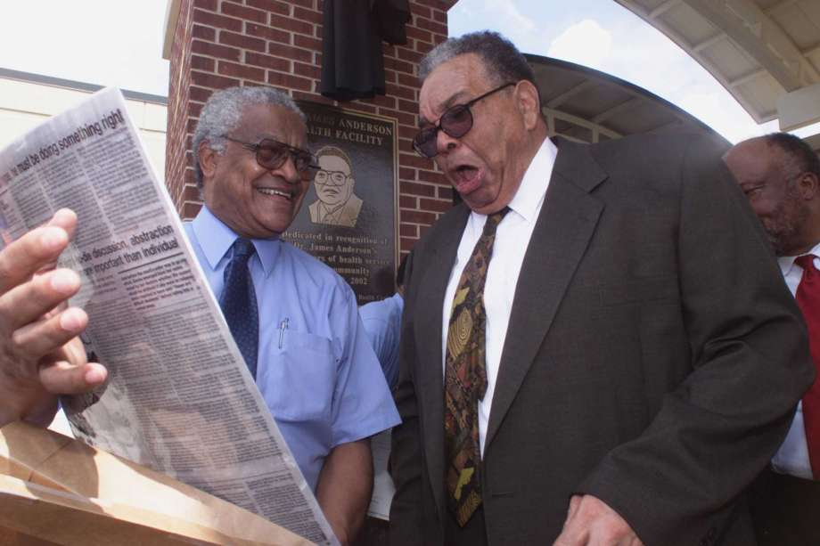 In this Aug. 19, 2002 photo, Dr. Aaron Shirley, left, and Dr. James Anderson share a private laugh after the conclusion of ceremonies naming the Jackson-Hinds Comprehensive Health Center in Jackson, Miss., in honor of Anderson. Anderson died Monday, Feb. 18, 2019 at age 82 at the University of Mississippi Medical Center. He had worked for more than 50 years to provide health care in low-income, uninsured and minority communities. Anderson was one of the first three African-American doctors to earn full hospital privileges in the Mississippi State Medical Association. (J.D. Schwalm/The Clarion-Ledger via AP) Photo: J.D. Schwalm, AP / Copyright 2002. The Clarion-Ledger. All rights reserved