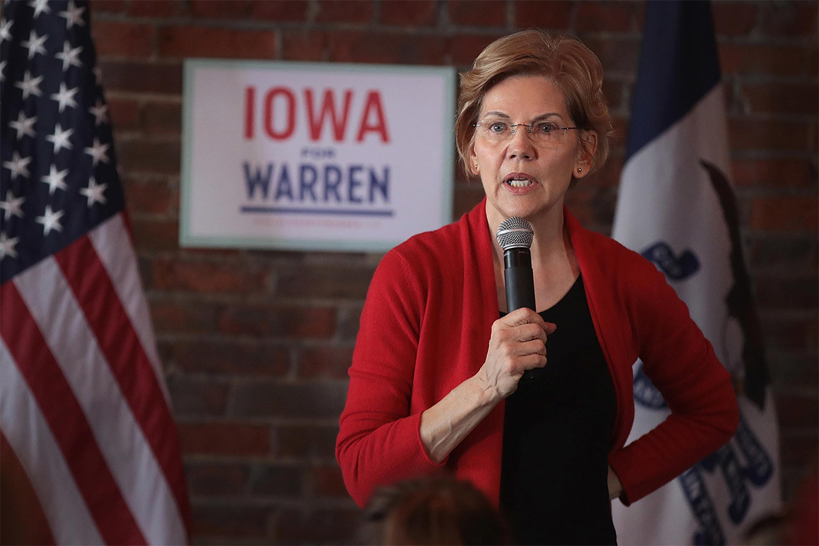 "Senator Elizabeth Warren speaks onstage in front of a sign reading ""Iowa for Warren"""