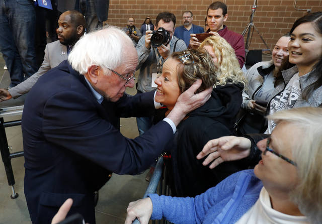 2020 Democratic presidential candidate Sen. Bernie Sanders, left, meets with Sarah Bass of Boone, after a rally, Saturday, March 9, 2019, at the Iowa state fairgrounds in Des Moines, Iowa. (AP Photo/Matthew Putney)