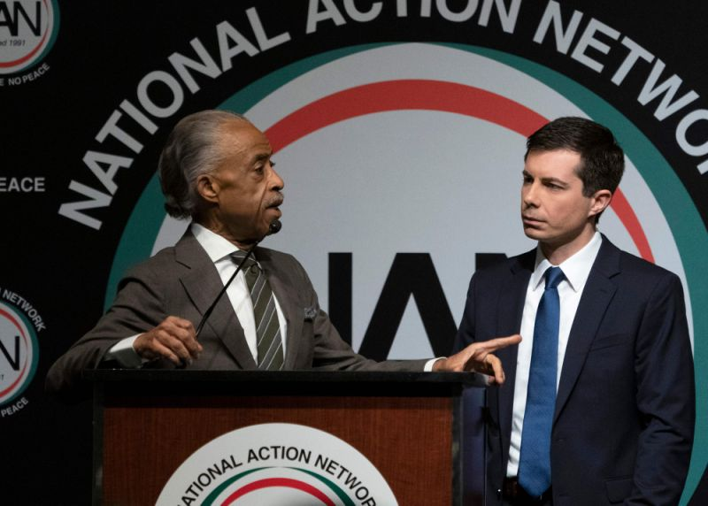 The Reverend Al Sharpton (L) asks a question of Democratic presidential candidate Pete Buttigieg during a gathering of the National Action Network in New York on April 4, 2019.