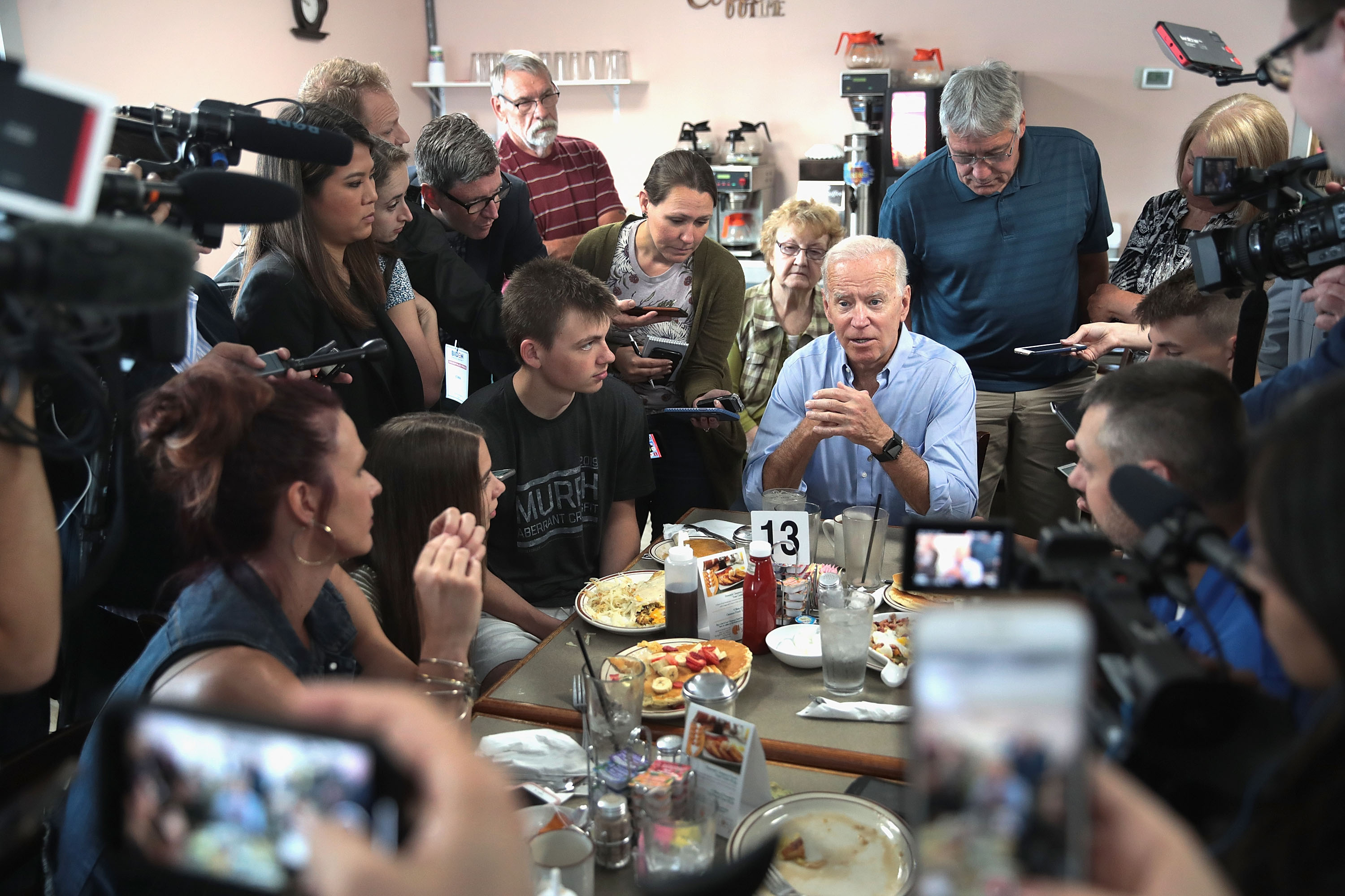 Democratic presidential candidate and former U.S. vice president Joe Biden speaks to diners at the Tasty Cafe during a quick campaign stop on June 12, 2019 in Eldridge, Iowa. (Photo by Scott Olson/Getty Images)