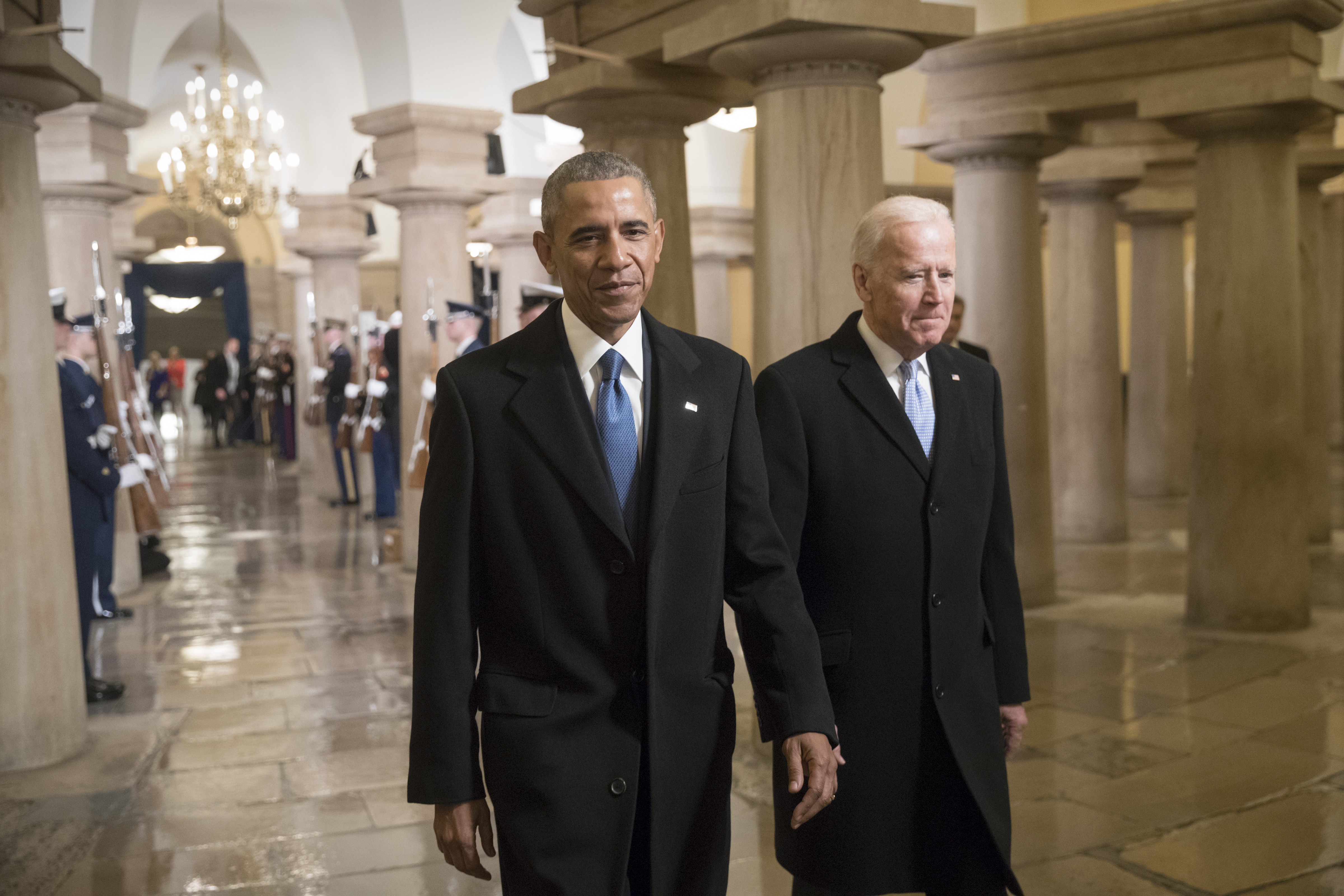 President Barack Obama and Vice President Joe Biden walk through the Crypt of the Capitol for Donald Trump's inauguration ceremony, in Washington, January 20, 2017. (Photo by J. Scott Applewhite - Pool/Getty Images)
