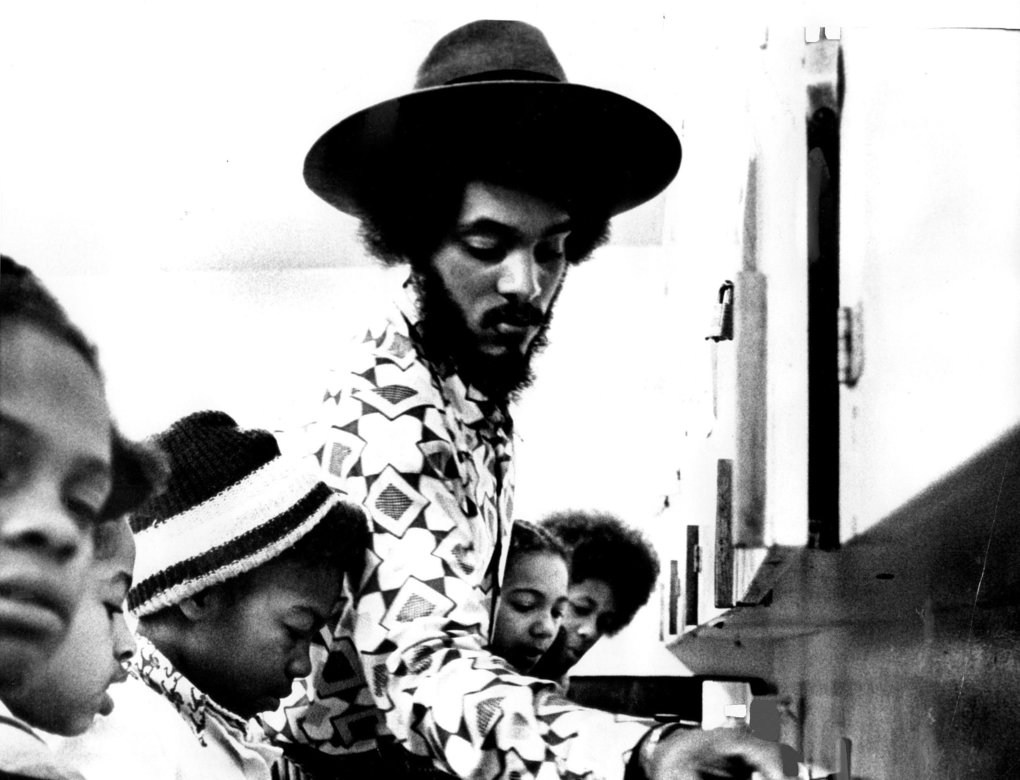 While NASA was putting a man on the moon, movements like the Black Panther Party created programs that fit into their own vision for the future. Here Black Panther Party Seattle co-founder Elmer Dixon prepares free breakfast for schoolchildren in 1975. (Peter Liddell / The Seattle Times, file)