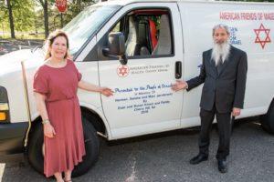 Susan and Evan Krisch in front of a Magen David Adom ambulance