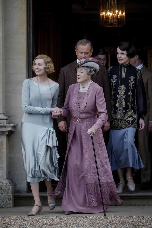 "Laura Carmichael, left, stars as Edith Crawley, Maggie Smith as Violet Crawley, Hugh Bonneville as Robert Crawley, Allen Leech as Tom Branson and Elizabeth McGovern as Cora Crawley in ""Downton Abbey."" (Jaap Buitendijk / Focus Features)"