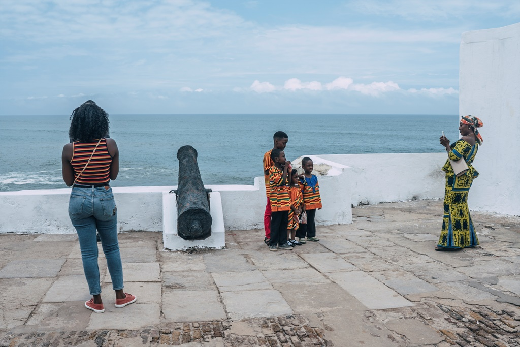 Tourists pose for pictures at the Cape Coast Castl
