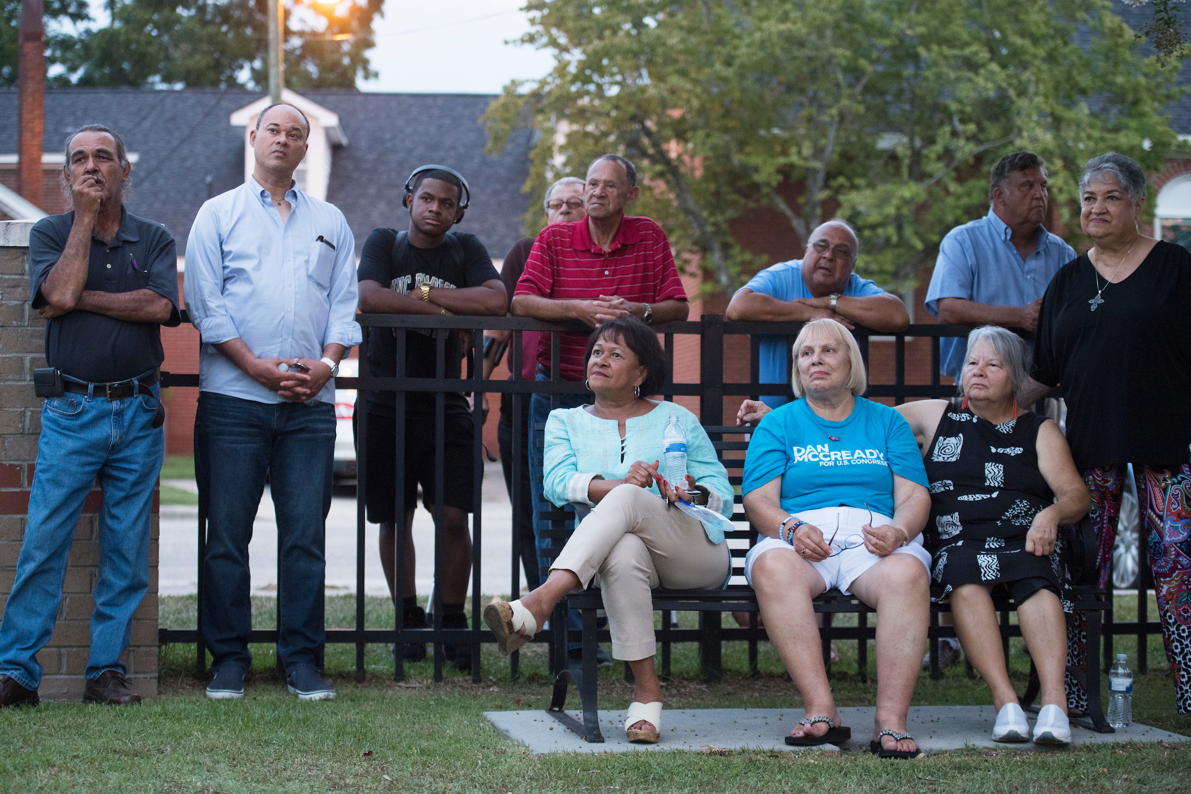 UNITED STATES - AUGUST 10: Voters listen to Dan McCready, Democratic candidate for North Carolina's 9th District, speak outside of the First United Methodist Church during his education tour in Pembroke, N.C., on Saturday, August 10, 2019. (Photo By Tom Williams/CQ Roll Call)