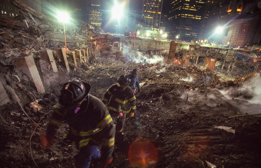 Fall 2001: Members of New York Fire Department Rescue Company 5 search the World Trade Center site looking for victims of the Sept. 11 terror attacks.