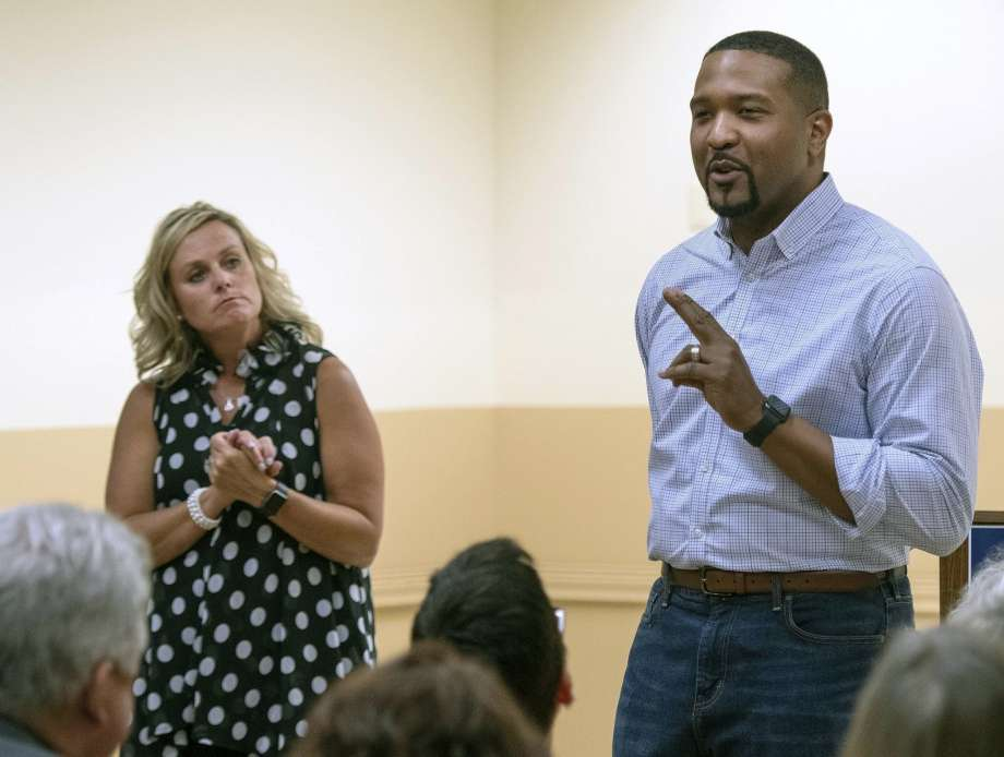 In this Tuesday, July 30, 2019 photo, Democratic State Sen. Eddie Melton, right, and state superintendent of public instruction Jennifer McCormick speak at a town hall in Hammond, Ill. Melton is formally entering the Indiana governor's race on Tuesday, Oct. 8 with McCormick, the state's Republican schools chief, expected by his side. The first-term senator, of Gary, told The (Northwest Indiana) Times that he's joining the 2020 race because most people feel that the Republican-led state government isn't focused on issues like increased education funding and health care access that matter the most. (Michael Gard/Post-Tribune)/Chicago Tribune via AP) Photo: Michael Gard, AP / Chicago Tribune