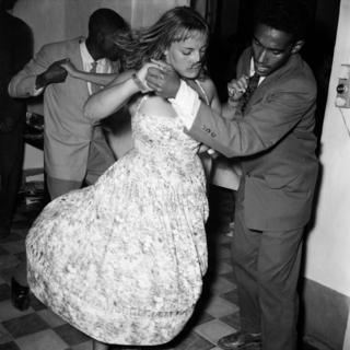 Men and women dance in couples.