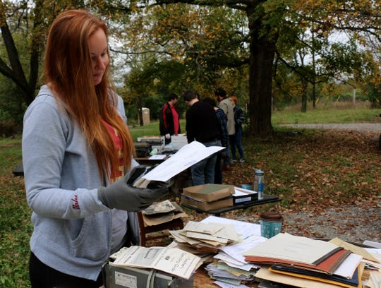 Meggan McCarthy reads through a document found in the John Carothers House on Oct. 29, 2019.