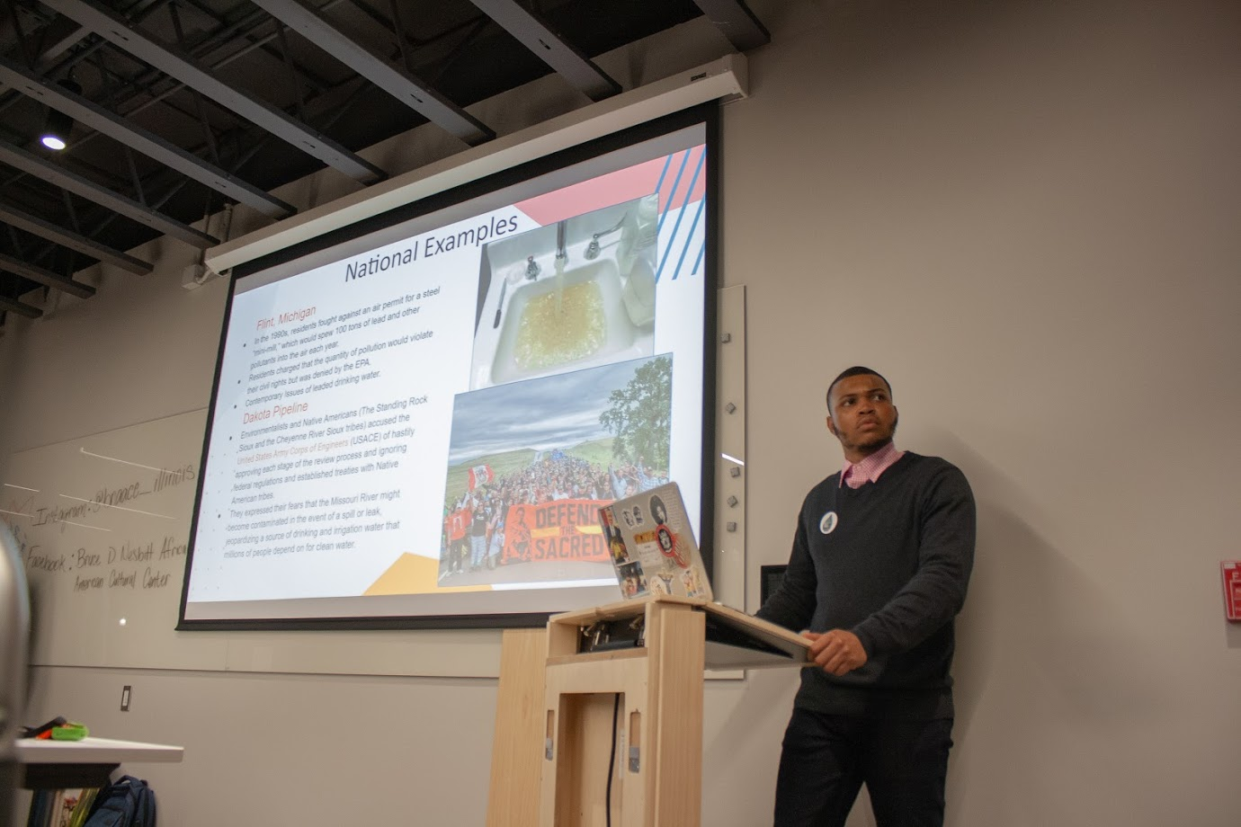Khiren Johnson , senior in FAA, speaks on his concerns about toxins in the Fifth and Hill neighborhood at the Bruce D. Nesbitt African American Cultural Center on Nov. 21. Of the $3,000 required, RSOs have raised $1,756 to purchase indoor vapor testing kits.