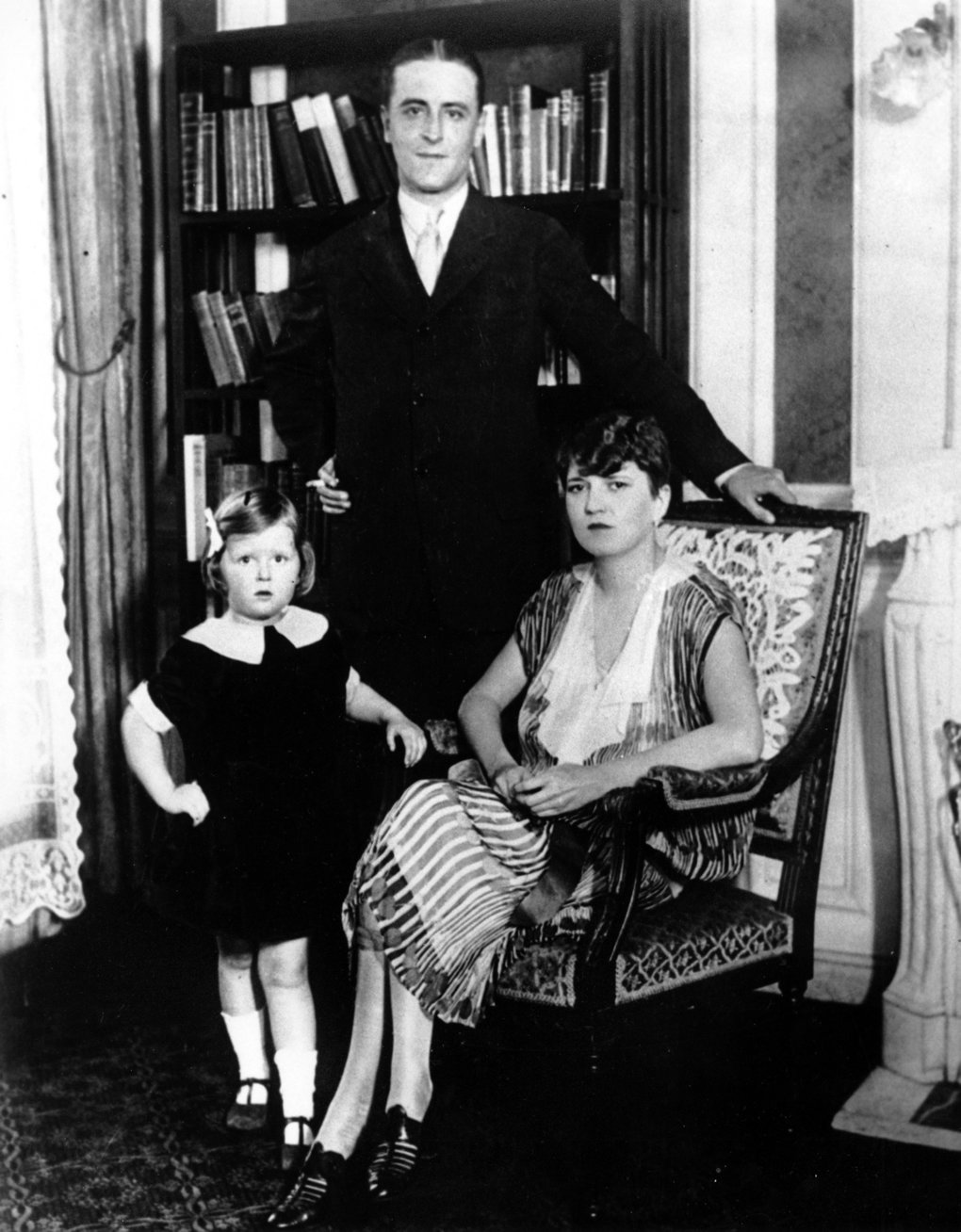 Author F. Scott Fitzgerald poses with his wife, Zelda, and his daughter Scottie in their apartment in Paris on July 16, 1925. (The Associated Press)
