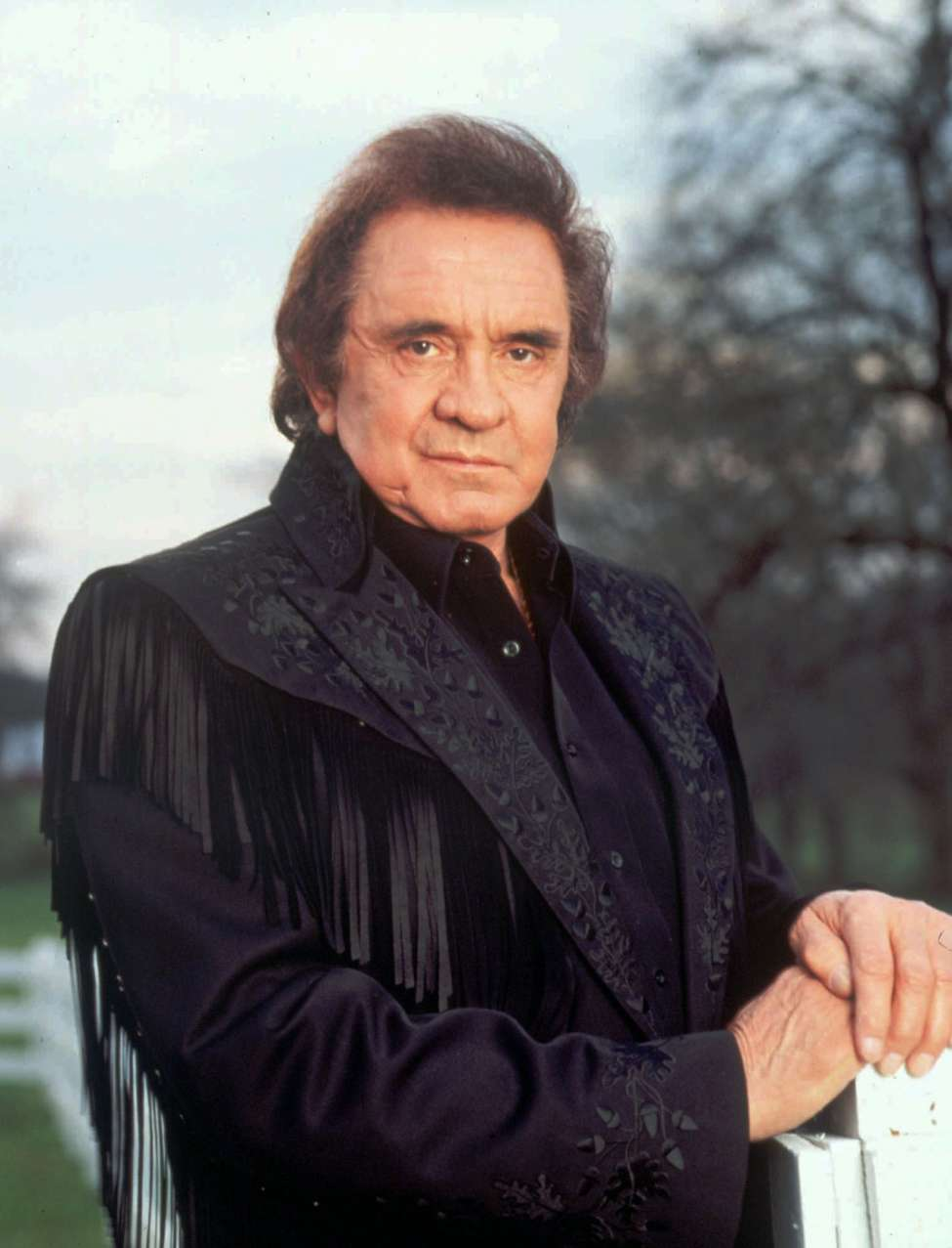 FILE--Country singer Johnny Cash poses for a portrait in this 1995 file photo. Cash, 69, was hospitalized Sunday, Oct. 7, 2001 with bronchitis and was listed in stable condition on Tuesday. (AP Photo/TBS, File)