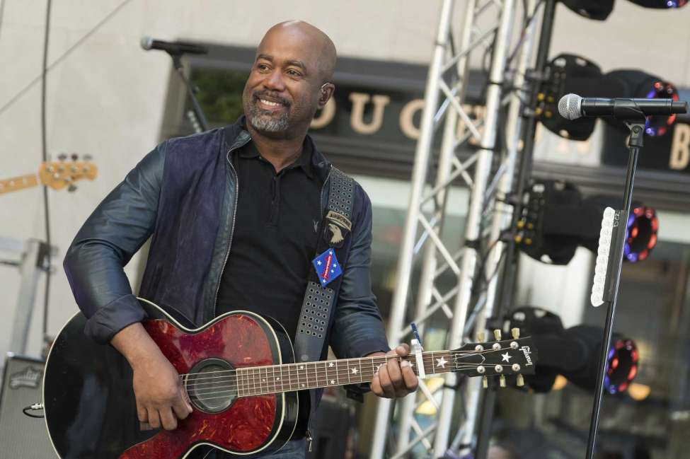 FILE - In this May 25, 2018 file photo, Darius Rucker performs on NBC's Today show at Rockefeller Plaza in New York. The Country singer couldna€™t quite believe it when he was surprised this week with the news that his song a€œWagon Wheela€ was certified eight times platinum, making it one of the top five most popular country singles ever. On Wednesday, Feb. 12, 2020, Rucker stopped by the Country Music Hall of Fame and Museum to his items in an exhibit, but his label, Universal Music Group Nashville, surprised him with a plaque featuring eight platinum-colored records. (Photo by Charles Sykes/Invision/AP, File)