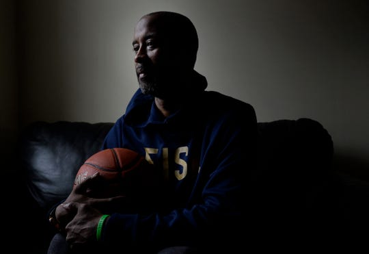 Fisk basketball coach Kenny Anderson sits at his home on March 12, 2020, in Nashville.